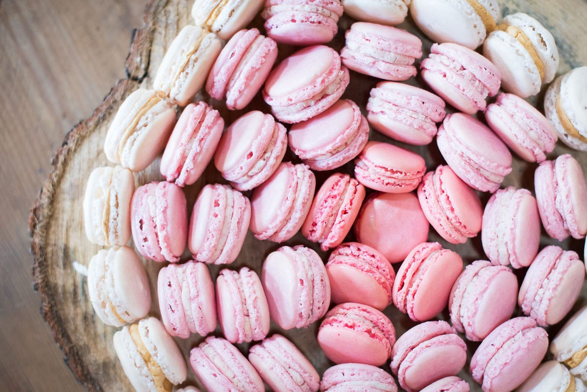 Pink Macaroons arranged on a board