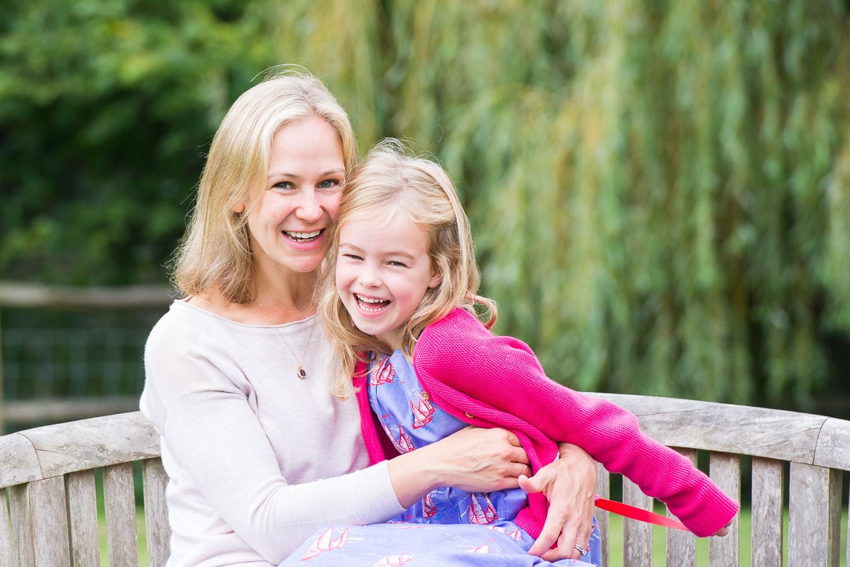 Natural picture of mother and her daughter laughing in their Sussex garden
