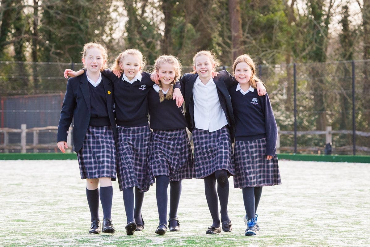 school girls walking in the snow laughing