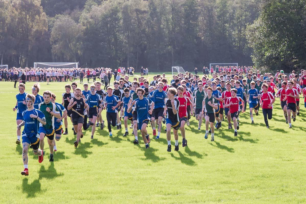 School children running a cross country race