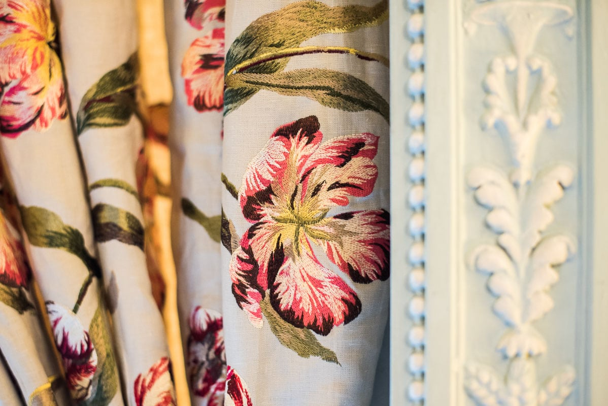 A close up detail picture of a patterned curtain
