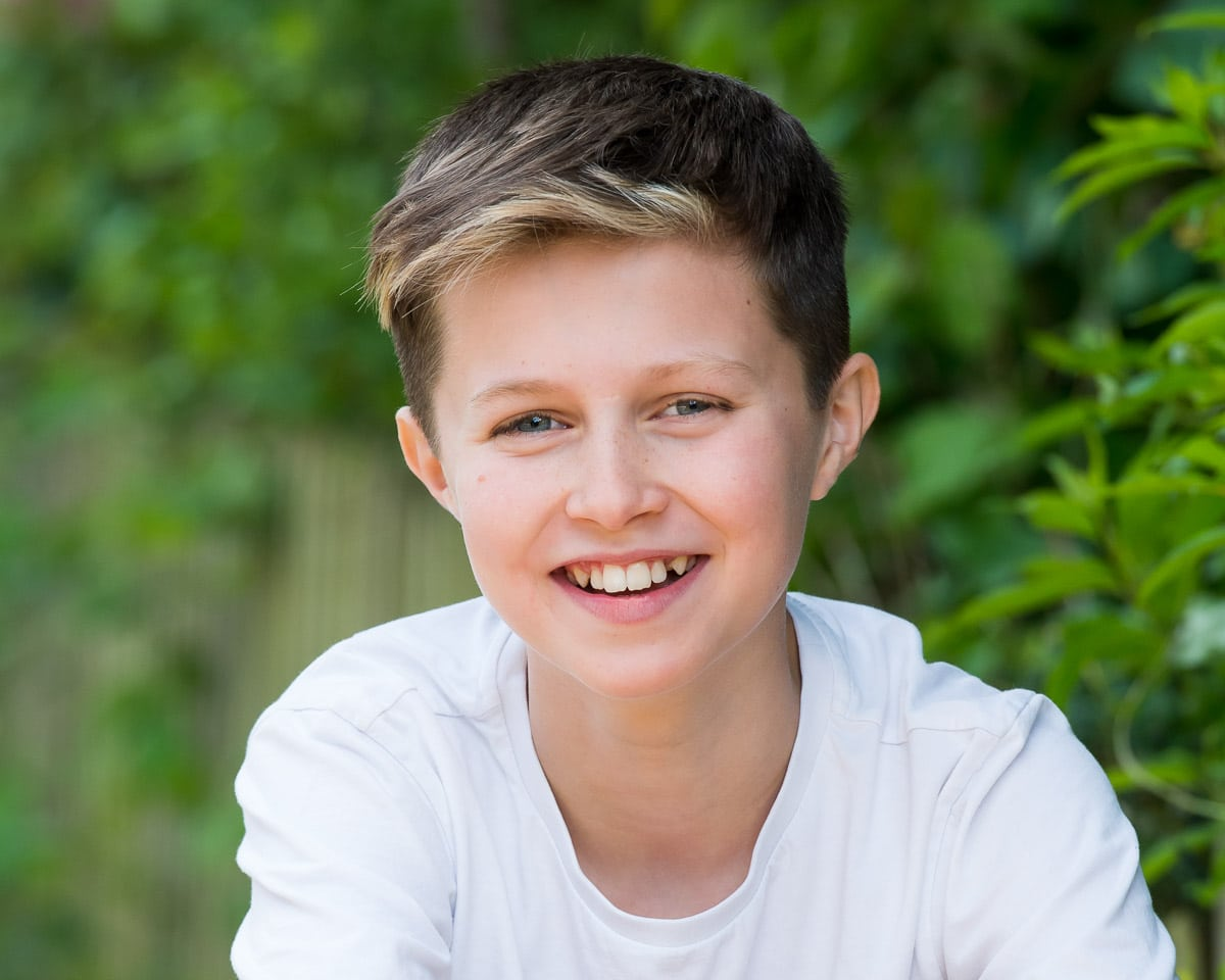 b/w headshot of a young child actor smiling