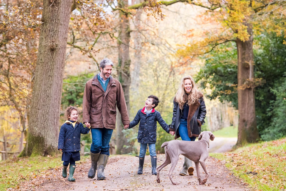 Family walking with their dog during Autumn