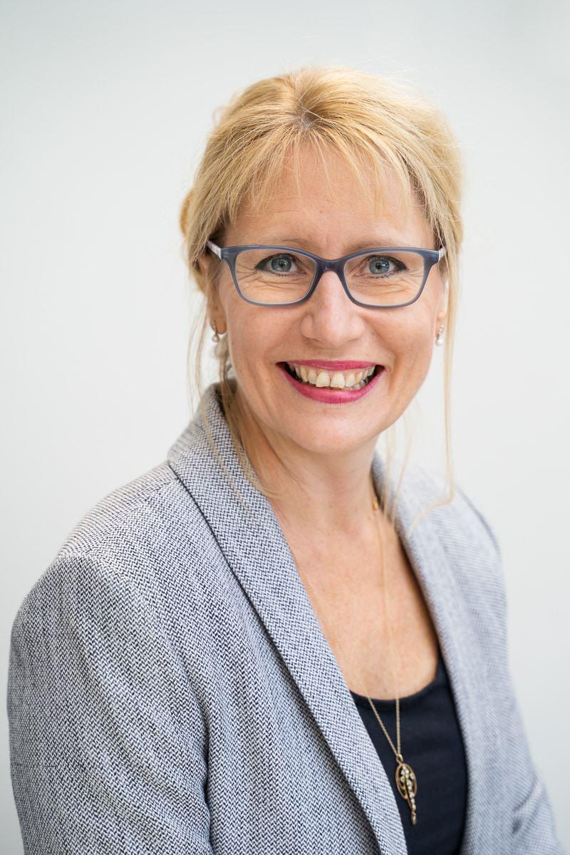 Woman smiling at camera wearing glasses