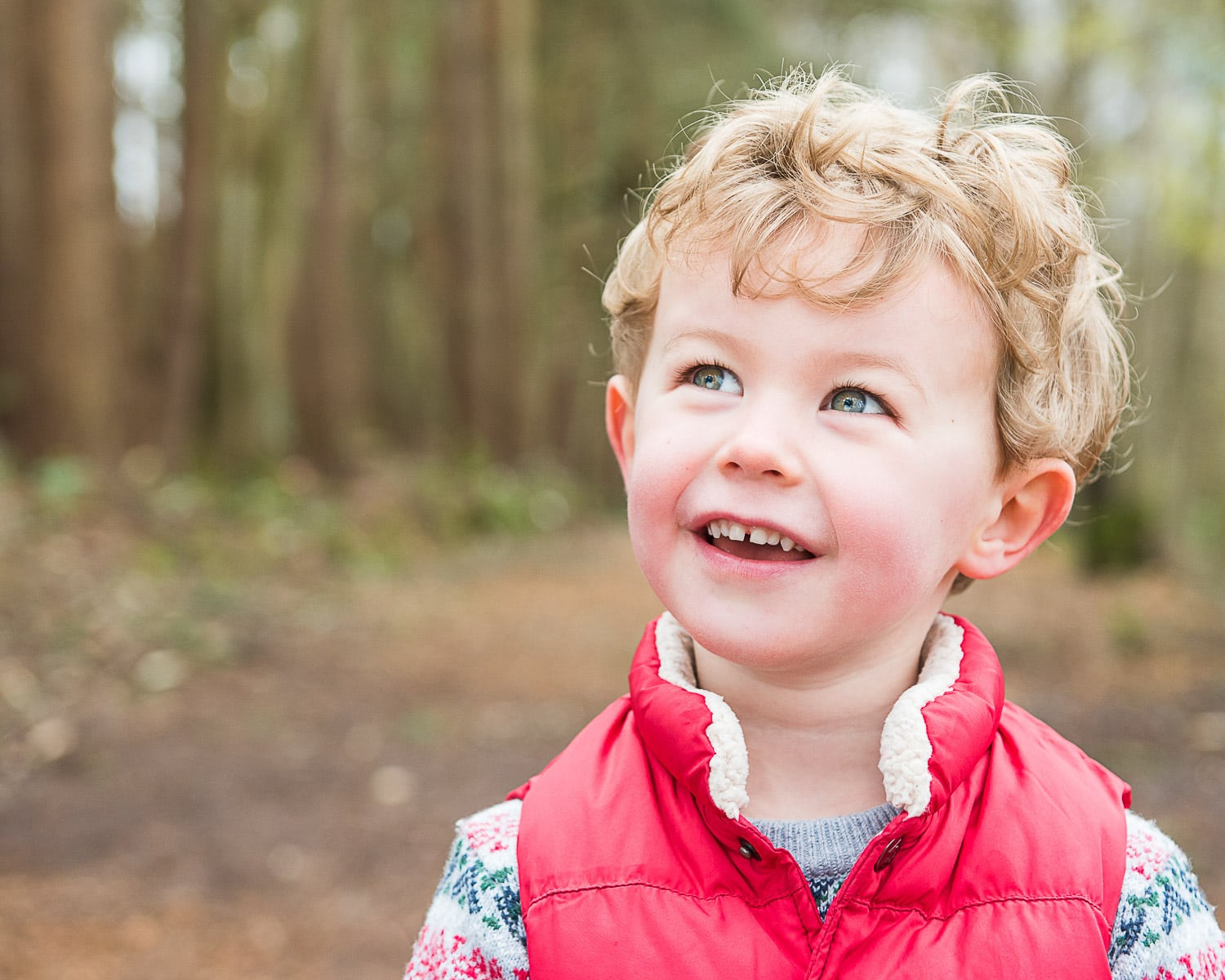 Natural looking photo of young boy outside in a Sussex park