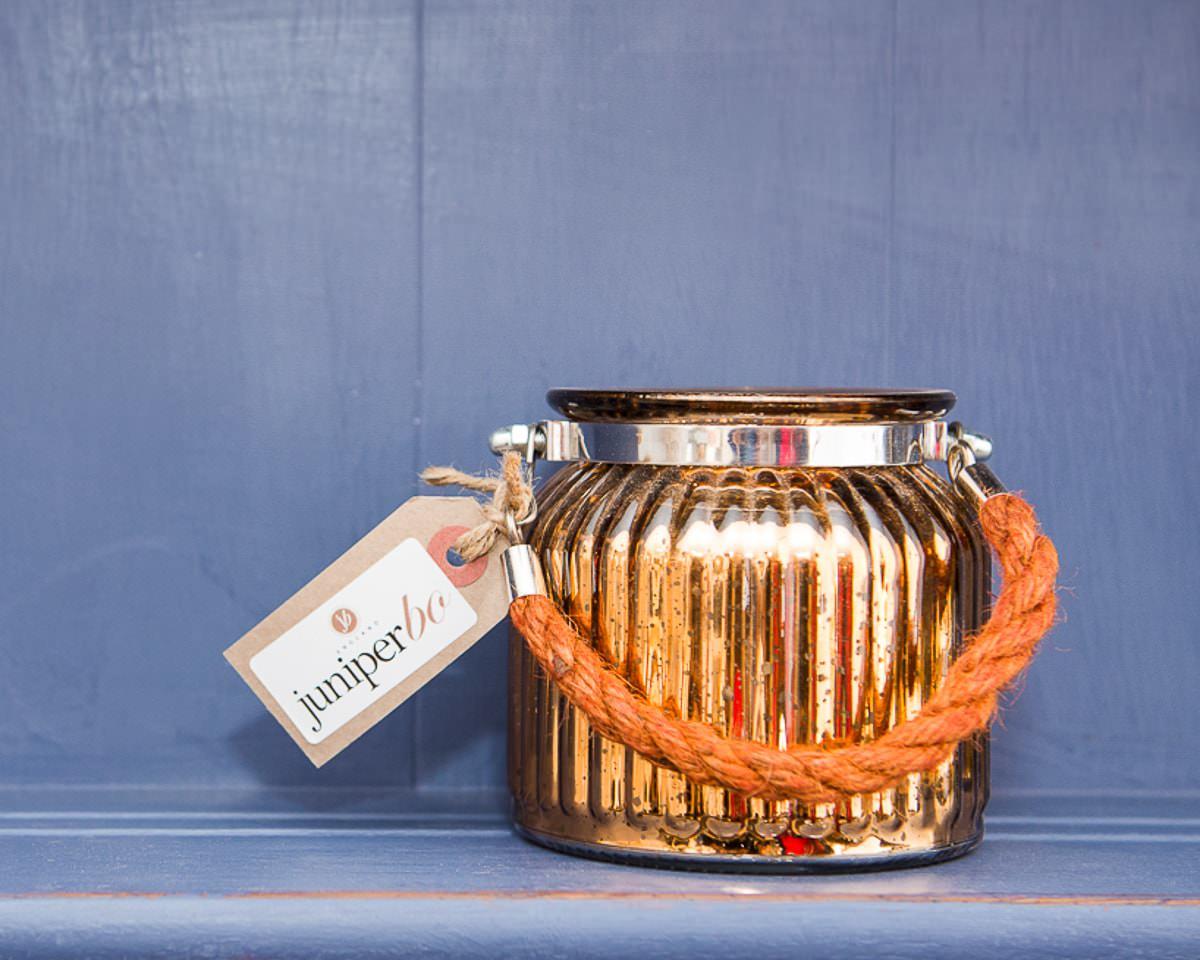 glass jar with orange handle sitting on blue shelf